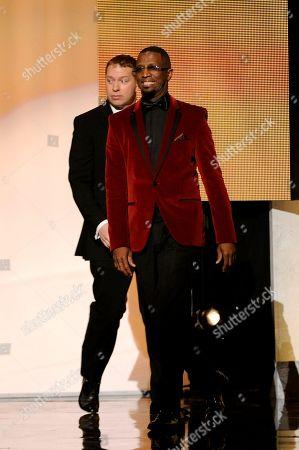 Rickey Smiley walks on stage at the 45th NAACP Image Awards at the Pasadena Civic Auditorium, in Pasadena, Calif