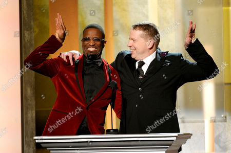 Rickey Smiley, left, and Gary Owen speak on stage at the 45th NAACP Image Awards at the Pasadena Civic Auditorium, in Pasadena, Calif