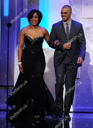 NAACP chairman Roslyn M. Brock, left and Shemar Moore walk on stage at the 45th NAACP Image Awards at the Pasadena Civic Auditorium, in Pasadena, Calif