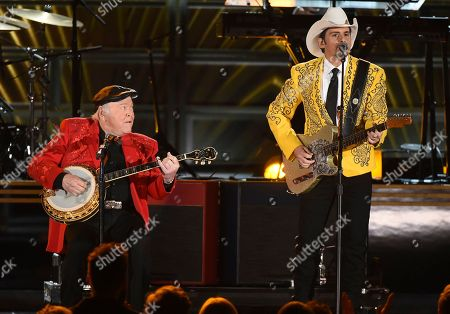 """Stock Picture of Roy Clark, left, and Brad Paisley perform """"I''ve Got a Tiger By The Tail"""" at the 50th annual CMA Awards at the Bridgestone Arena, in Nashville, Tenn"""