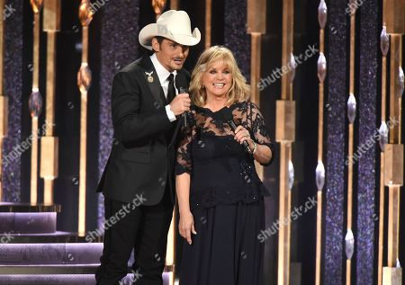 Brad Paisley, left, and Barbara Mandrell introduce a performance by Garth Brooks and Trisha Yearwood at the 50th annual CMA Awards at the Bridgestone Arena, in Nashville, Tenn