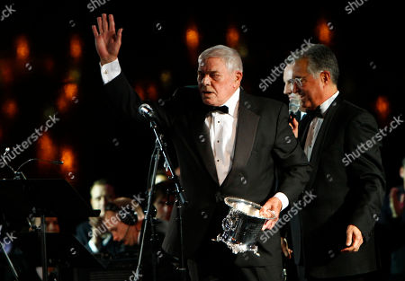 Stock Image of Tom T. Hall waves to the crowd after receiving the Icon Award at the 60th Annual BMI Country Awards, in Nashville