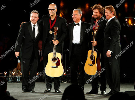 Luke Laird, second from the left, and Dallas Davidson, fourth from the left, stand with Jody Williams, left, Del Bryant, center, and Clay Bradley after winning Songwriter's of the Year at the 60th Annual BMI Country Awards, in Nashville, Tenn