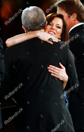 Martina McBride gets a hug from Del Bryant at the 60th Annual BMI Country Awards, in Nashville