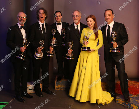 SEPTEMBER 23: (L-R) Producer Steven Shareshian, director Jay Roach, writer Danny Strong, producer Gary Goetzman, and actors Julianne Moore and Tom Hanks pose backstage at the Academy of Television Arts & Sciences 64th Primetime Emmy Awards at Nokia Theatre L.A. Live on in Los Angeles, California