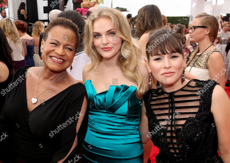 Stock Photo of Michelle Hurst, and from left, Madeline Brewer and Yael Stone arrive at the 66th Primetime Emmy Awards at the Nokia Theatre L.A. Live, in Los Angeles