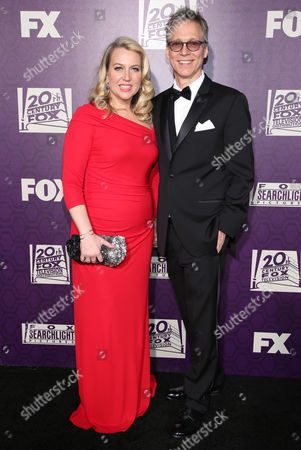 Cheryl Strayed, left, and Brian Lindstrom arrive at the Fox Searchlight Golden Globes afterparty at the Beverly Hilton Hotel, in Beverly Hills, Calif