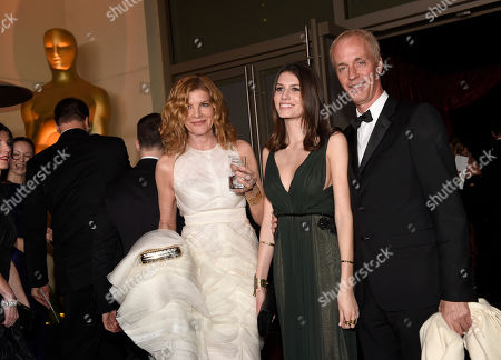From left, Rene Russo, Rose Gilroy and Dan Gilroy attend the Governors Ball after the Oscars, in Los Angeles