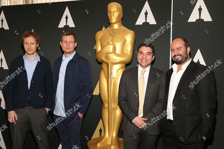 László Nemes, left, Tobias Lindholm, Naji Abu Nowar and Ciro Guerra arrive at the 88th Academy Awards Foreign Language Films at Samuel Goldwyn Theater, in Beverly Hills, Calif