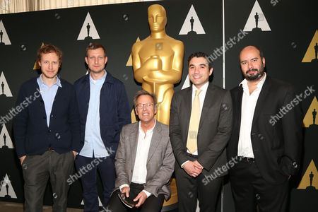 Stock Picture of László Nemes, left, Tobias Lindholm, Mark Johnson, middle, Naji Abu Nowar and Ciro Guerra arrive at the 88th Academy Awards Foreign Language Films at Samuel Goldwyn Theater, in Beverly Hills, Calif