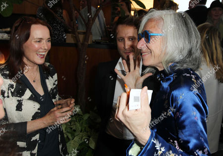 Dr. Jane Aronson, right, founder and chief executive of Worldwide Orphans, right, greets Laura Innes as Amy Poehler hosts Worldwide Orphans Salon Event presented by Shutterfly in Los Angeles