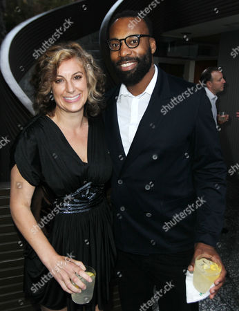 Baron Davis, right, and Kirsten Smith pose together as Amy Poehler hosts Worldwide Orphans Salon Event presented by Shutterfly in Los Angeles