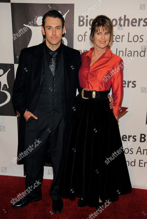 Stock Photo of Actress Pam Dawber and her son Sean Harmon pose together at the Big Brothers Big Sisters of Greater Los Angeles' 2013 Rising Stars Gala at the Beverly Hilton Hotel on in Beverly Hills, Calif