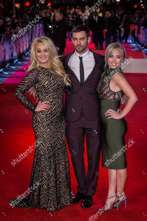"""From left, Kirsty-Leigh Porter, Cameron Moore and Jorgie Porter pose for photographers upon arrival at the premiere of the film """"Daddy's Home"""" in London"""