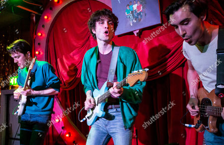 Will Taylor, centre, of British four-piece Indie band Flyte, performs on stage at Bethnal Green Working Men's Club, in east London