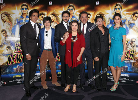 Stock Picture of Director Farah Khan, centre red, poses for photographers with actors, from left, Sonu Sood, Vivaan Shah, Abhishek Bachchan, Boman Irani, Shah Rukh Khan and Deepika Padukone, during a photo call for the film, Happy New Year-SLAM, at the Montcalm hotel in central London