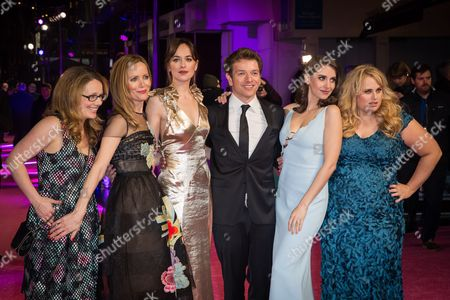 From left, producer Dana Fox, actresses Leslie Mann, Dakota Johnson, director Christian Ditter, actresses Alison Brie and Rebel Wilson pose for photographers upon arrival at the premiere of the film 'How To Be Single' in London