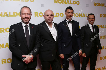 From left, Anthony Wonke, Paul Martin, Cristiano Ronaldo and Jorge Mendes pose for photographers upon arrival at the world premiere of the film 'Ronaldo, in London