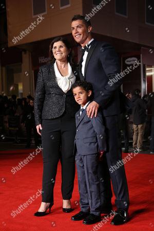 Maria Dolores dos Santos Aveiro, left Cristiano Ronaldo, right, and his son Cristiano Ronaldo Junior, pose for photographers upon arrival at the world premiere of the film 'Ronaldo, in London