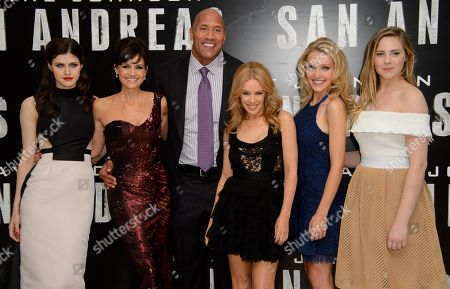 U.S actress, Alexandra Daddario, left, U.S actress, Carla Gugino, U.S actor, Dwayne Johnson, Australian singer, Kylie Minogue, U.S actress, Breanne Hill and Australian actress Morgan Griffin pose for photographers at the world premiere of San Andreas at a central London cinema