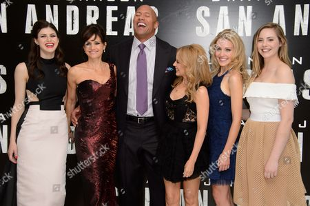 Alexandra Daddario, Carla Gugino, Dwayne Johnson, Kylie Minogue, Breanne Hill and Morgan Griffin pose for photographers at the world premiere of San Andreas at a central London cinema