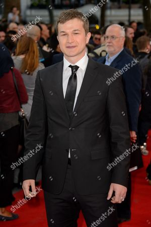 Alec Utgoff poses for photographers at the world premiere of San Andreas at a central London cinema