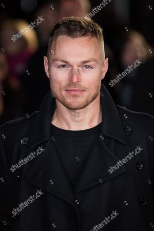 Andrew Hayden-Smith poses for photographers upon arrival at the world premiere of the film 'The Pass' in London