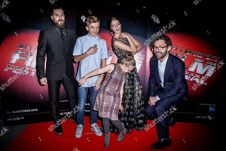 From left, director Robert Eggers, Harvey Scrimshaw, Ellie Grainger, Anya Taylor-Joy and producer Jay Van Hoy pose for photographers upon arrival at the premiere of the film The Witch in London