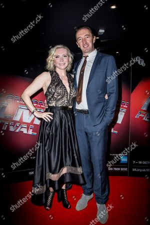 Stock Image of Ali Milner Ineson and Ralph Ineson pose for photographers upon arrival at the premiere of the film The Witch in London
