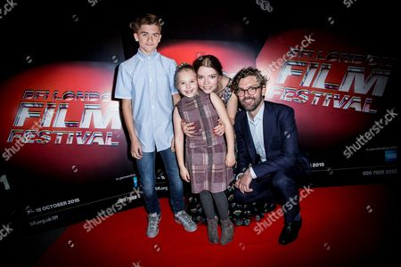 From left, Harvey Scrimshaw, Ellie Grainger, Anya Taylor-Joy and producer Jay Van Hoy pose for photographers upon arrival at the premiere of the film The Witch in London