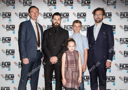 From left, Ralp Ineson, director Robert Eggers, Harvey Scrimshaw, producer Jay Van Hoy and Ellie Grainger pose for photographers upon arrival at the premiere of the film The Witch in London