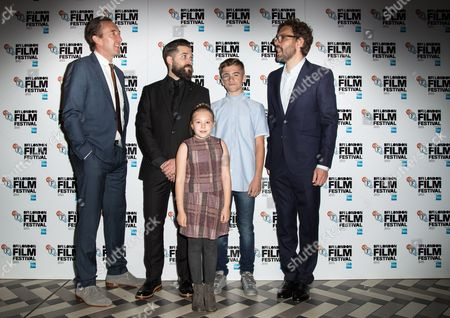 From left, Ralph Ineson, director Robert Eggers, Harvey Scrimshaw, producer Jay Van Hoy and Ellie Grainger pose for photographers upon arrival at the premiere of the film The Witch in London, as part of the London film festival in London