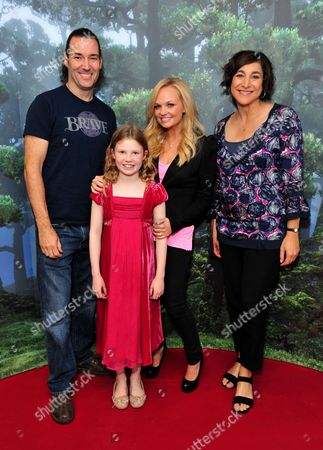 Mark Andrews, the director of Disney PixarÕs Brave, Great Ormond Street Patient Catriona Bricknell, Emma Bunton and film producer Katherine Sarafian poses as patients celebrate the opening of a new Disney play area and enjoyed an exclusive mini premiere of Disney Pixar's new release Brave, at Great Ormond Street Hospital, on in London