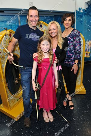 Mark Andrews, the director of Disney Pixar's Brave, Great Ormond Street Patient Catriona Bricknell, Emma Bunton and film producer Katherine Sarafian poses as patients celebrate the opening of a new Disney play area and enjoyed an exclusive mini premiere of Disney Pixar's new release Brave, at Great Ormond Street Hospital, on in London