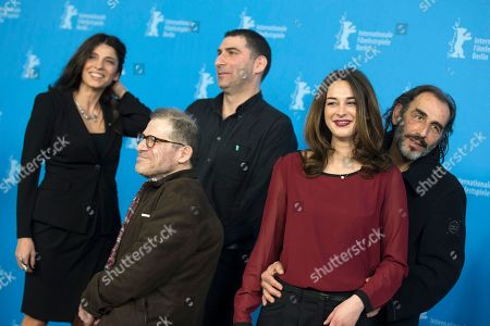 Stock Picture of From left, actors Popi Tsapanidou and Petros Zervos, director Yannis Economides and actors Vicky Papadopoulou and Vangelis Mourikis pose for photographers at the photo call for the film Stratos during the 64th Berlinale International Film Festival, in Berlin