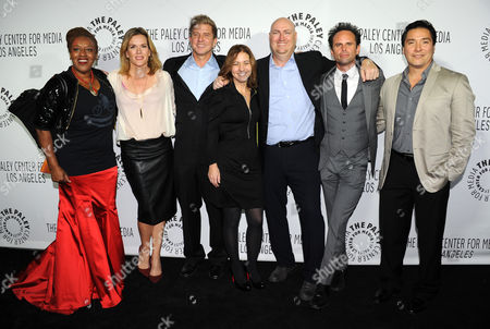 IMAGE DISTRIBUTED FOR FX NETWORKS - From left, CCH Pounder, Catherine Dent, Kenny Johnson, Cathy Cahlin Ryan, Shawn Ryan, Walton Goggins, and Benito Martinez of The Shield attend the 2013 Benefit Gala Honoring FX Networks with the Paley Prize for Innovation and Excellence on in Los Angeles