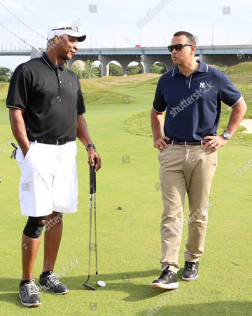 Alex Rodriguez, right, and Darryl Strawberry attend the Hank's Yanks 1st Annual Golf Classic at Trump Golf Links, in New York