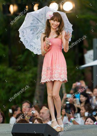 Yuri Ebihara walks on the runway at the Hawaii May! Collection fashion show at the Royal Hawaiian Hotel, in Honolulu