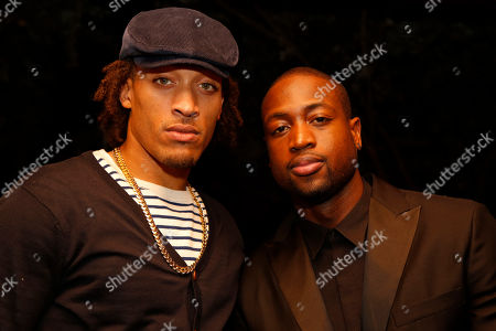 """Miami Heat teammates Michael Beasley and Dwyane Wade attend the """"Hennessy V.S Celebrates the GQ MEN Book"""" at Hyde Beach at the SLS Hotel South Beach on in Miami Beach, Fl"""