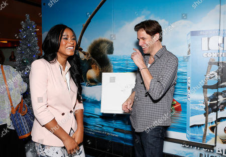 "Keke Palmer and Artist Peter de Seve celebrate the December 11th Blu-ray, DVD and Digital HD release of ICE AGE: CONTINENTAL DRIFT at the Beverly Center in Los Angeles, California on Thursday, December 6. Twentieth Century Fox Home Entertainment and Taubman Shopping Centers across the country have partnered to commemorate ""National Signing Santa Day"" and the industry first Blu-ray special feature with picture-in-picture sign language interpretation"