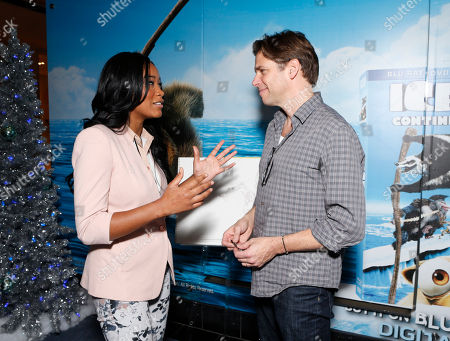 "Stock Photo of Keke Palmer and Artist Peter de Seve celebrate the December 11th Blu-ray, DVD and Digital HD release of ICE AGE: CONTINENTAL DRIFT at the Beverly Center in Los Angeles, California on Thursday, December 6. Twentieth Century Fox Home Entertainment and Taubman Shopping Centers across the country have partnered to commemorate ""National Signing Santa Day"" and the industry first Blu-ray special feature with picture-in-picture sign language interpretation"