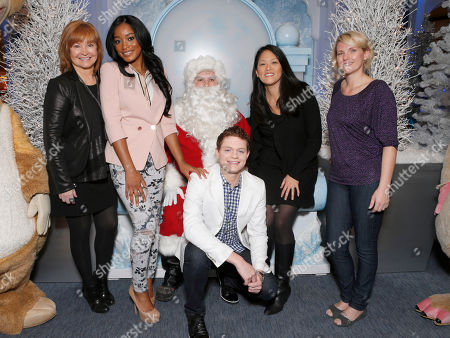 """Taubman Centers' Glenda Cole, Keke Palmer, Santa Claus, Sean Berdy, Twentieth Century Fox Home Entertainment's Jennifer Chai and Amber Zion celebrate the December 11th Blu-ray, DVD and Digital HD release of ICE AGE: CONTINENTAL DRIFT at the Beverly Center in Los Angeles, California on Thursday, December 6. Twentieth Century Fox Home Entertainment and Taubman Shopping Centers across the country have partnered to commemorate """"National Signing Santa Day"""" and the industry first Blu-ray special feature with picture-in-picture sign language interpretation"""