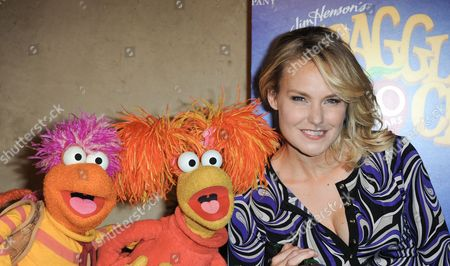 Red Fraggle, left, Gobo Fraggle, and Laura Allen arrive at Jim Henson's Fraggle Rock 30th Anniversary at Hollywood Roosevelt Hotel on in Los Angeles