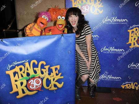 Red Fraggle, left, Gobo Fraggle, and Jackie Geary arrive at Jim Henson's Fraggle Rock 30th Anniversary at Hollywood Roosevelt Hotel on in Los Angeles