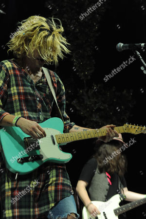 Christian Zucconi, at left, and Sean Gadd of Grouplove performs at KROQ Almost Acoustic Christmas, in Los Angeles