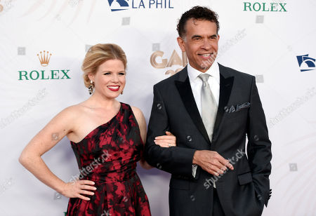 Musical performers Megan Hilty, left, and Brian Stokes Mitchell arrive at the Los Angeles Philharmonic's Walt Disney Concert Hall Opening Night Concert and Gala, in Los Angeles