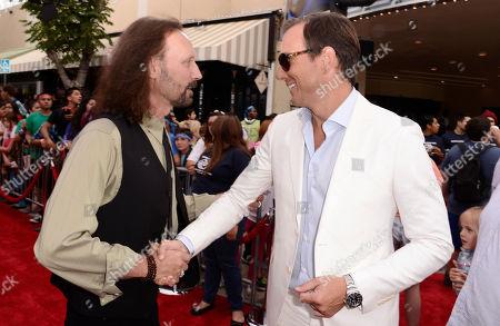 "Producer Scott Mednick, left, and Will Arnett arrive at the Los Angeles premiere of ""Teenage Mutant Ninja Turtles"" at the Regency Village Theater on"
