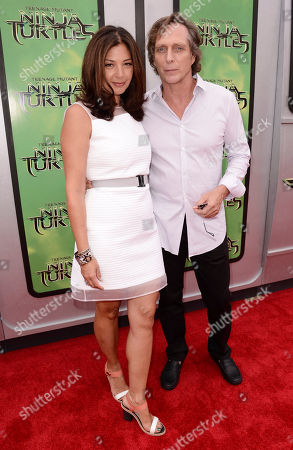 """Kymberly Kalil, left, and William Fichtner arrive at the Los Angeles premiere of """"Teenage Mutant Ninja Turtles"""" at the Regency Village Theater on"""