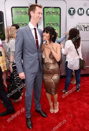 "Jeremy Howard, left, and Minae Noji arrive at the Los Angeles premiere of ""Teenage Mutant Ninja Turtles"" at the Regency Village Theater on"