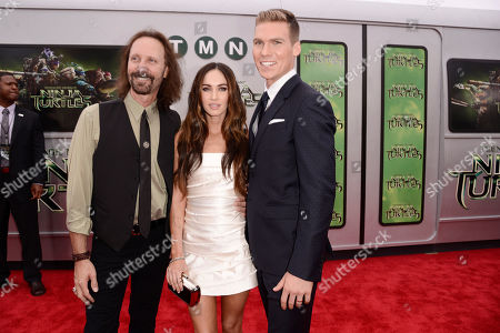 """Stock Image of Producer Scott Mednick, and from left, Megan Fox and Pete Ploszek arrive at the Los Angeles premiere of """"Teenage Mutant Ninja Turtles"""" at the Regency Village Theater on"""